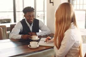 Two People Having Coffee While Talking · Free Stock Photo